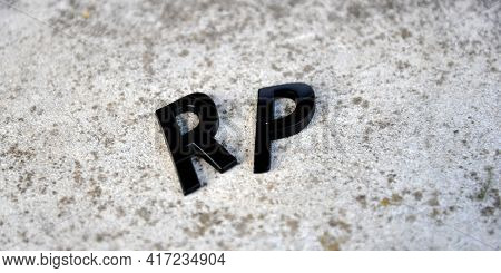 Metal Letters On A Concrete Background .image