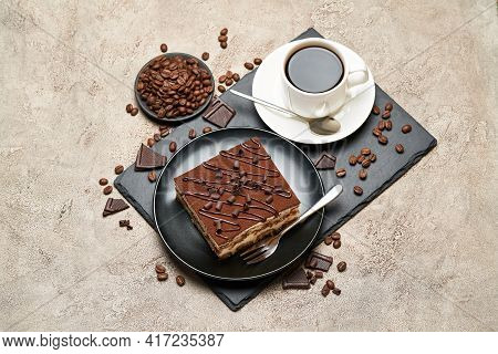 Portion Of Traditional Italian Tiramisu Dessert And Cup Of Coffee On Grey Concrete Background