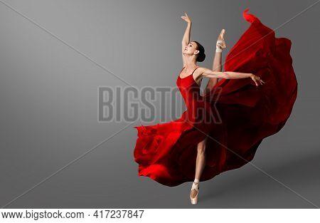 Ballerina Dance. Ballet Dancer In Red Dress Jumping Spit. Woman In Ballerina Shoes Dancing In Evenin