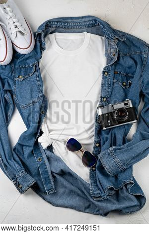 White T-shirt With Place For Text. Blue Denim Shirt, Sneakers, Glasses - A Set Of Clothes For Walkin