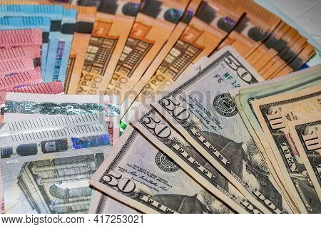 Detail Of Usd Banknotes And Euro Banknotes. Detail Of United States Dollar And European Union Euro.