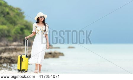 Happy Traveler And Tourism Young Women Travel Summer On The Beach. Asian Smiling People With White