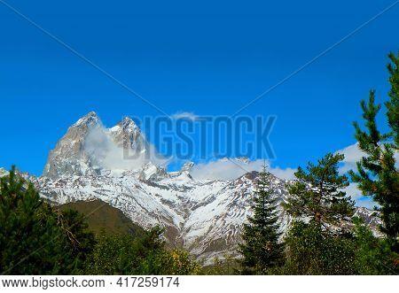 Amazing Mount Ushba With Its Double Summit Against Vivid Blue Sky, Greater Caucasus Range In Svaneti