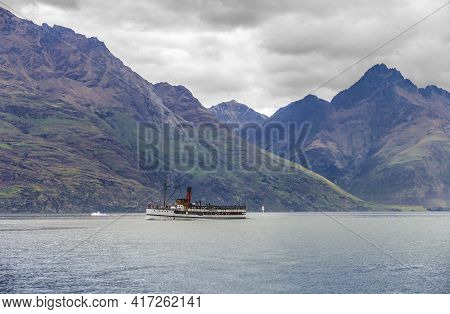 Impression Including A Steamship Around The Lake Wakatipu At The South Island In New Zealand