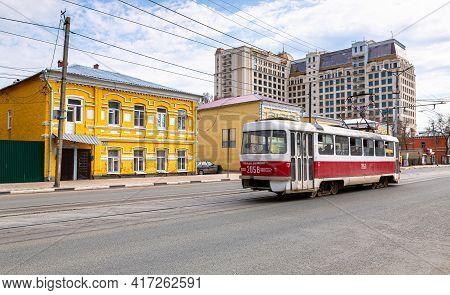 Samara, Russia - May 1, 2018: Russian Public Transport. Tram Runs On The City Street In Summer Day