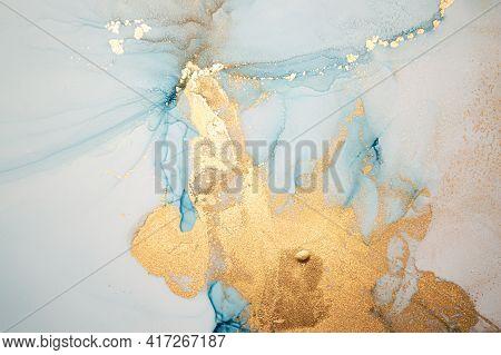 Luxury Abstract Background Liquid. Alcohol Ink Splash. Metallic Flow Wallpaper. Fluid Acrylic Paint.