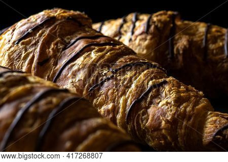 Croissant Black Background. Fresh Pastry Bread Or French Breakfast Croissants With Chocolate In Bake