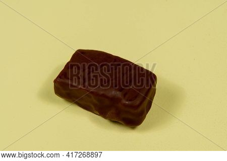 Chocolate Bonbon Isolated On Yellow Background. Brazilian Sweet