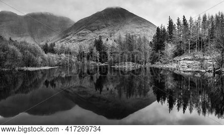 Beautiful  Black And White Landscape Image Of Torren Lochan In Glencoe In Scottish Highlands On A Wi