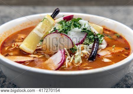 Spicy Pozole Stew Served Loaded With Meat And Vegetables In A Large Hearty Bowl.