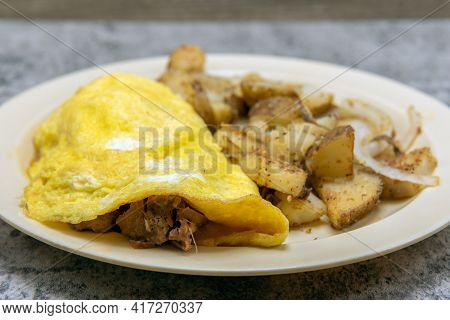 Chili Verde Pork Meat Omelette Served With Seasons Roasted Potatoes As A Traditional Mexican Food Br