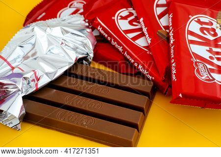 Tambov, Russian Federation - March 19, 2021 One Open Kitkat Chocolate Bar Surrounded By Other Kitkat