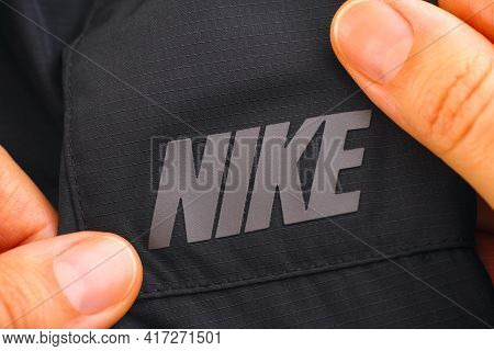 Tambov, Russian Federation - April 03, 2031 Logo Nike On Black Clothes In Woman Hands. Close-up.