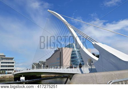 DUBLIN, IRELAND - MAY 12, 2011: The Samuel Beckett Bridge and Convention Center. The bridge joins Sir John Rogerson's Quay to Guild Street and North Wall Quay in the Docklands area.