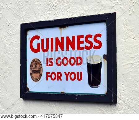 DUBLIN, IRELAND - 17 MAY 2011: Closeup of a Guinness sign on the side of a pub.