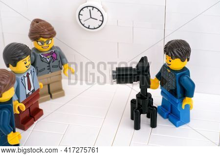 Tambov, Russian Federation - March 24, 2021 A Lego Photographer Taking Photographs Of Lego Businessp