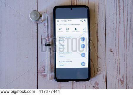 Mobile Phone With Arogya Setu Co-win App Application Showing Vaccine Tracking Used By Patients And D