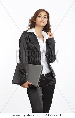 Businesswoman posing with a notebook