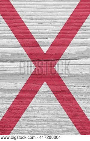 Alabama State Flag On Dry Wooden Surface. Light, Pale, Faded Paints. Vertical Background Or Backdrop