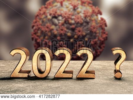 2022 Golden Coronaviurs In The Background. Concept Of Doubt And Uncertainty In The New Year With Cov