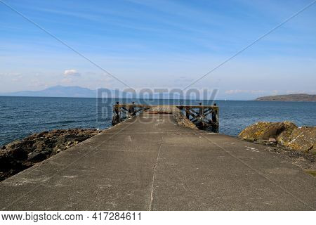 Old Concrete Jetty At A Coastal Location In Ayrshire Scotland