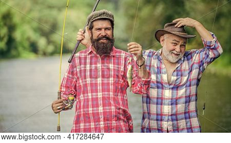 In Time Of Rest. Male Friendship. Family Bonding. Father And Son Fishing. Two Happy Fisherman With F