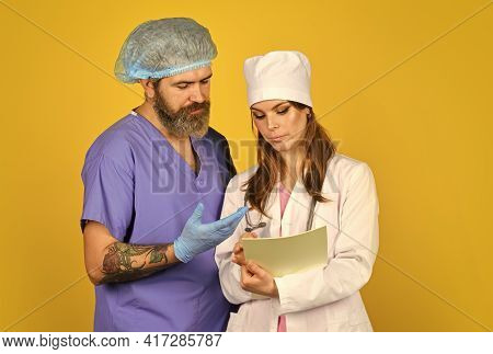 Virus Epidemic. Medical Treatment. Surgeon Assistant. Nurse And Doctor. Woman And Man Work At Hospit