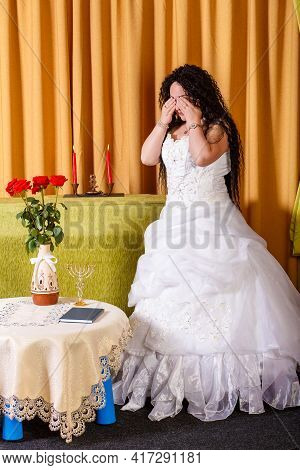 A Jewish Bride In A Wedding Dress With A Veil Stands In The Hall Crying Her Groom Left Her Before Th