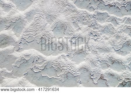 Surface Of Travertine. Ribs Of Structure Formed By Constant Mineral Water Flow, Just As Its Color