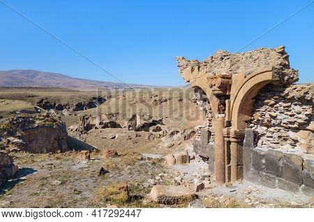 Broken Stone Arch & Walls On Edge Of Medieval City Ani, Near Kars, Turkey. Caved Gorge, Surrounding