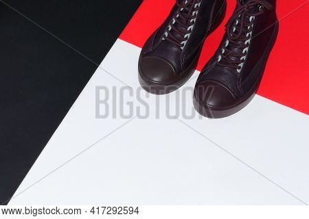 Womens Shoes. Stylish Womens Sneakers Or Boots On A Colored Background. High Quality Photo