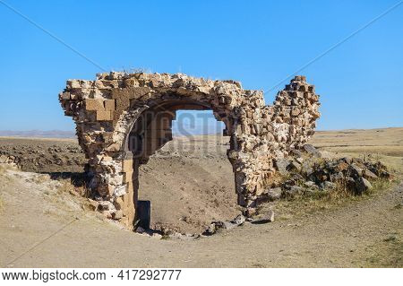 Remains Of Gate's Arch In Ancient Medieval City Ani, Near Kars, Turkey. Gate Located On Top Of Canyo