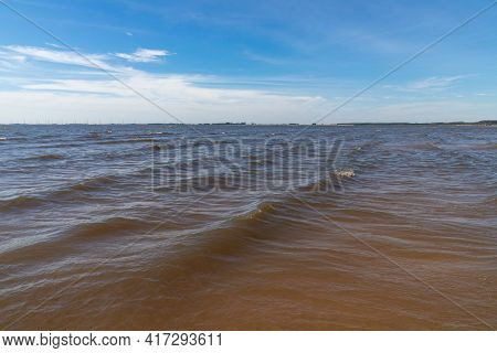 Waves In Lake With Blue Sky