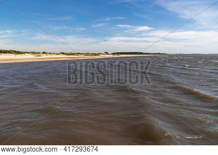 Sand And Lake With Blue Sky