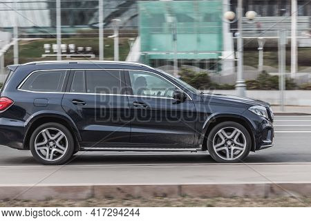 Black Full-size Luxury Suv Mercedes-benz Gl-class X166 Rides In The City Street. Side View Of Fast M