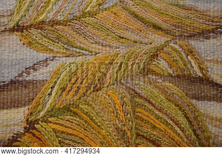 Background Of An Old Worn Carpet Sewn With Thick Threads.