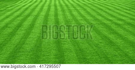 Grass Lawn. The Laid Grass Lawn On The Football Field As An Abstract Background.