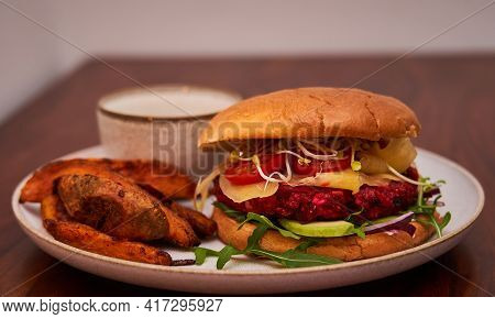 Veggie Burger Beet Root With Fries On Plate