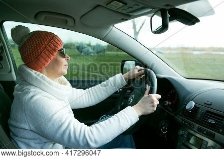 Dnepropetrovsk, Ukraine - 08.04.2021: Portrait Of A Beautiful Woman Driving A Car. A Woman Often Dri