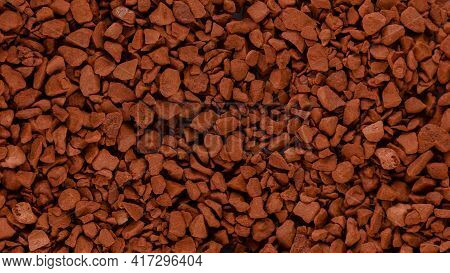 Instant Coffee Granules Lying On A Flat Surface, Panorama.