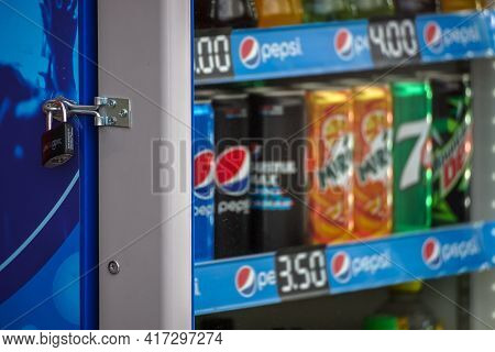 Bucharest, Romania - March 29, 2021 A Fridge Showcase With Several Brands Of Carbonated Drinks In Co