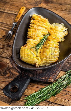 Potato Casserole Gratin In A Plate With Herbs. Wooden Background. Top View