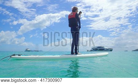 Whitehaven Beach, Whitsundays, Queensland, Australia - April 2021: Slim Young Woman In Stinger Suit