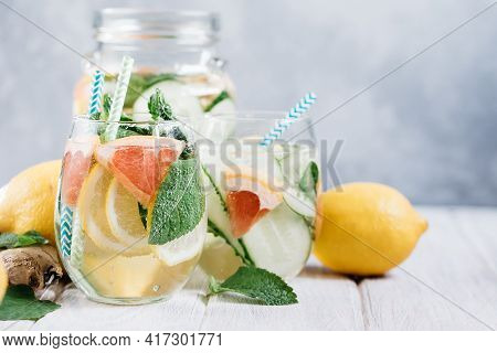 Detox Refreshing Sassy Water With Cucumber, Ginger, Mint And Lemon In Glasses, Healthy Eating Concep