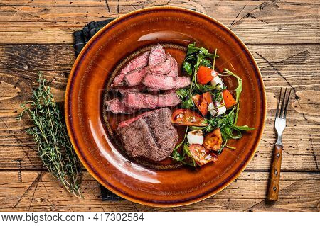 Bbq Roasted Oyster Top Blade Or Flat Iron Roast Beef Meat Steak On A Plate With Salad. Wooden Backgr