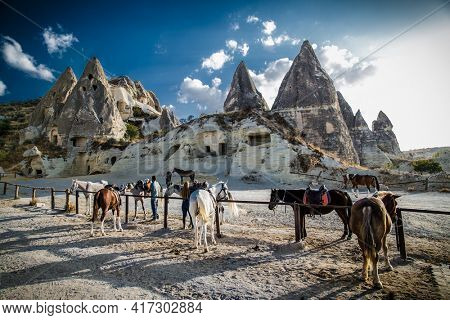 Goreme, Cappadocia- October 22, 2020 : Local people rent horses  for riding and photography in Love Valley in Cappadocia, Goreme, Turkey.