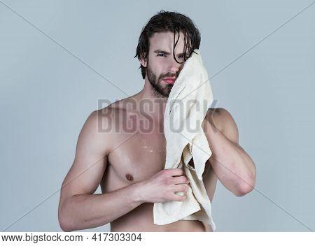 Man In Bathroom With Muscular Body On Grey Background. Morning Washing, Wake Up, Everyday Life. Hygi