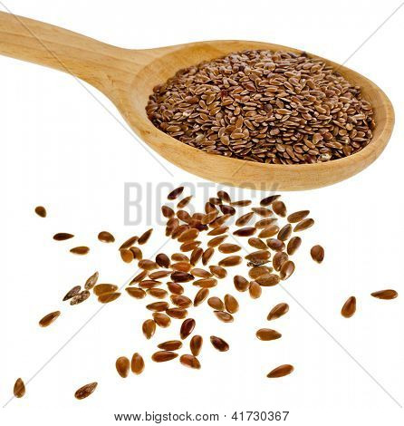 flax seed linseed in wooden spoon closeup isolated on white background