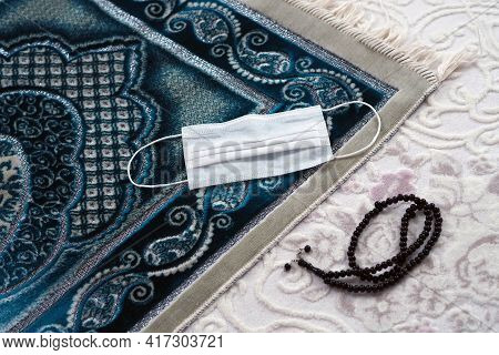 Worshiping With A Mask, Prayer Rug And Mask Despite The Coronavirus,