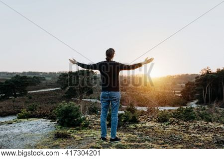 Hopeful Thoughtful Woman With Open Arms Holds Out Her Hands In The Air. Person In Nature Is Relaxed,